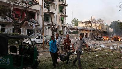 At least 10 killed in car bomb explosion, gunfire at a hotel in Somalia