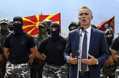 NATO Secretary General Jens Stoltenberg talks to members of Macedonian army special forces in Skopje on Sept. 6.