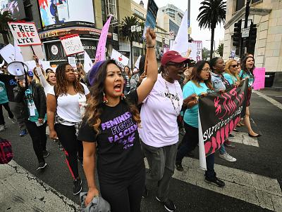 Women who are survivors of sexual harassment, assault and abuse and their supporters stage a #MeToo march in Hollywood on Nov. 12, 2017.