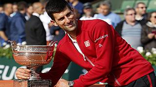 Djokovic crushes Andy Murray to win his first French Open title