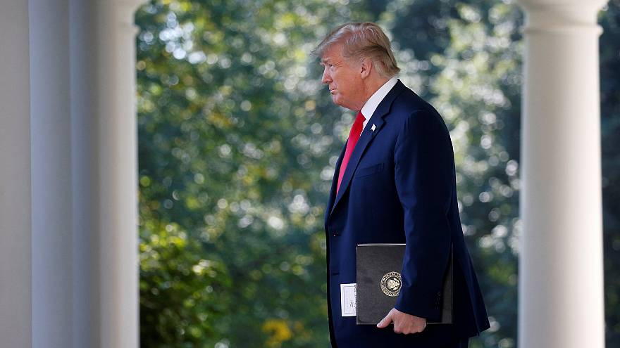 Image: President Trump arrives to announce trade deal in the Rose Garden of