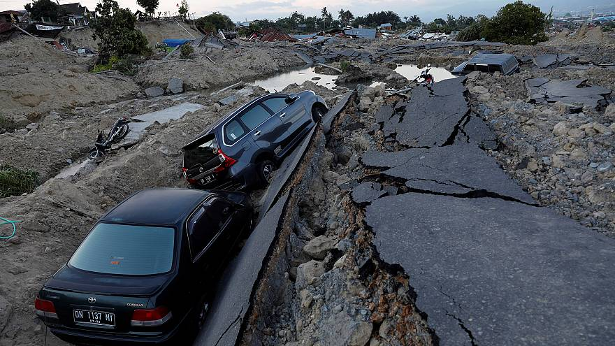 Image: Cars are trapped in sinking ground after an earthquake hit at Balaro