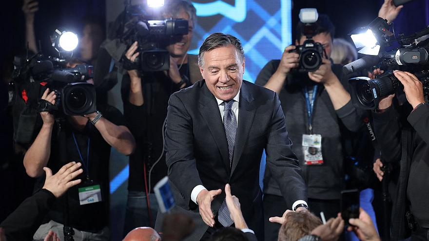 Image: CAQ party leader Legault shakes hands with supporters in Quebec City