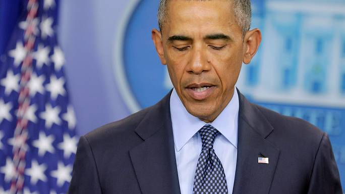 Obama condemns an 'act of terror' and an 'attack on all of us'