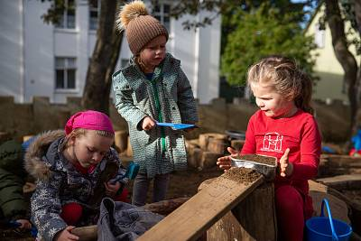Girls playing outside at the Laufasborg kindergarten in Reykjavik, Iceland.