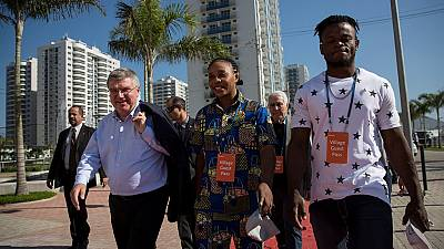 IOC's Bach visits Olympic village with refugee athletes