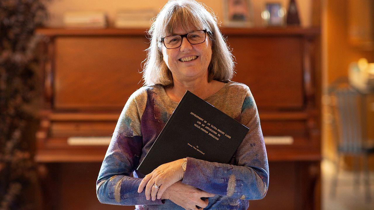 Image: Donna Strickland speaks on the phone after winning the Nobel Prize f