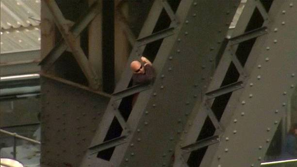 Man arrested after climbing up an arch of Sydney Harbour Bridge