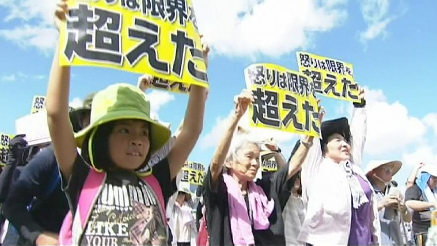 Okinawa rallies against US bases after woman's murder