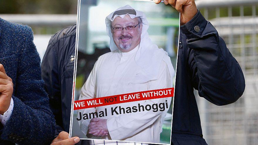 Image: A demonstrator holds picture of Saudi journalist Jamal Khashoggi dur