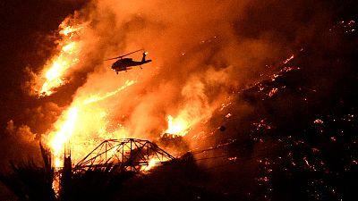 Bush fires rage amid brutal heatwave in southern California