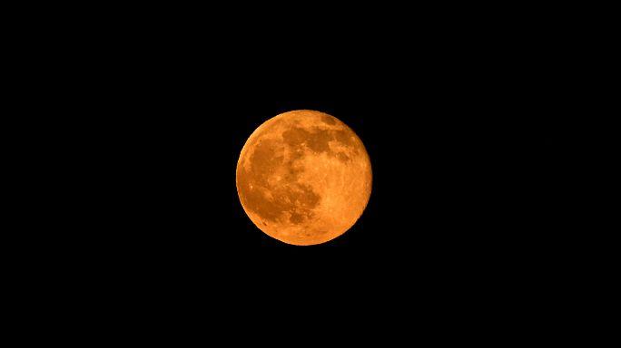 Strawberry moon lights up summer solstice