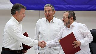 Colombia's government and main rebel army sign historic ceasefire deal in Cuba
