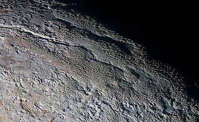 "The ""bladed terrain"" on Pluto, seen here by NASA\'s New Horizons spacecraft during the probe\'s 2015 flyby of the dwarf planet, is consistent with ice-tower features called penitentes."