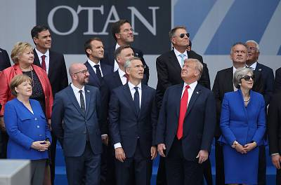 President Donald Trump stands with the leaders of other NATO nations during the organization\'s opening ceremony on July 1 in Brussels, Belgium.
