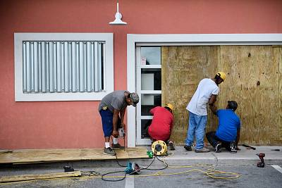 Workers board the windows of Marco\'s Pizza in Panama City Beach, Florida, as Hurricane Michael approaches on Oct. 9, 2018 .