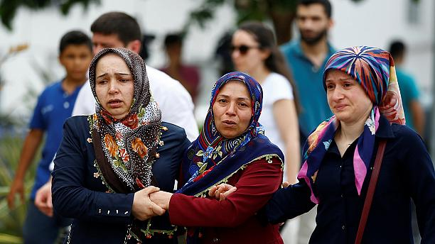 Forensic teams identify victims of Ataturk airport attack as relatives mourn