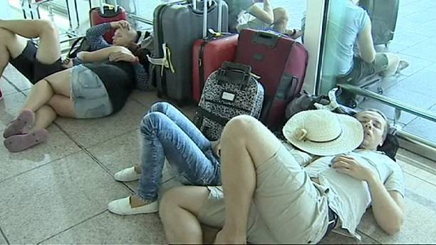 Holidaymakers stranded by delays and cancellations at Barcelona airport
