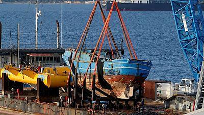 Italian authorities salvage sunken migrant vessel that killed hundreds in 2015