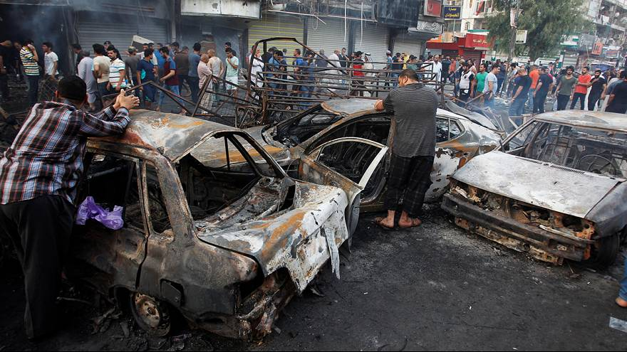 At least 80 killed, scores wounded in twin Baghdad bombings