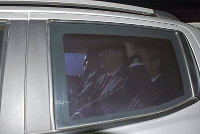 Andrew Brunson, center, sits inside a car as he arrives for his trial in Izmir Friday.