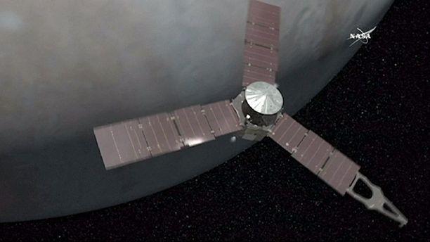 NASA's Juno probe slips into Jupiter's orbit