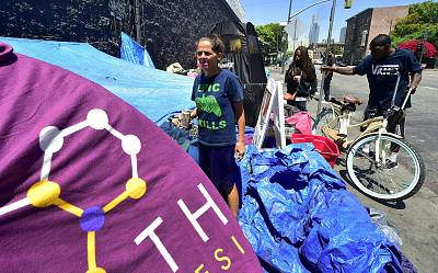 Homeless since August 2016, Tina Marie Van Tasil holds a can of beer while standing in front of her tent near Skid Row in downtown Los Angeles on June 20, 2017.