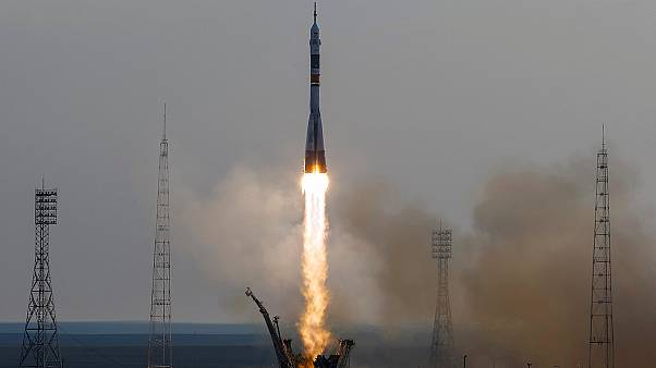 Mutinational three-member crew heads for Space Station in next generation Soyuz capsule