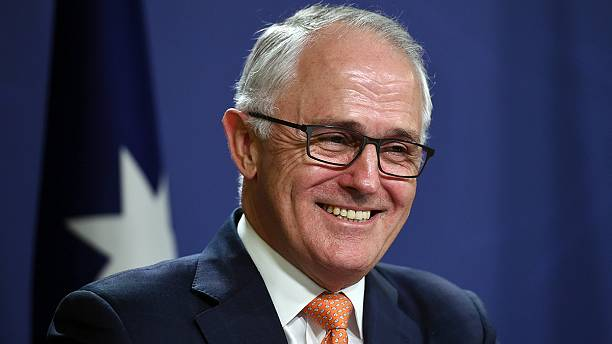 Australian PM declares narrow election victory