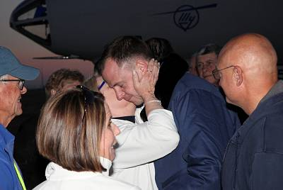 "Nick Hague greets family members, after the ""Soyuz"" spacecraft made an emergency landing following a failure of its booster rockets, upon the arrival at Baikonur airport, Kazakhstan, on Oct. 11, 2018."