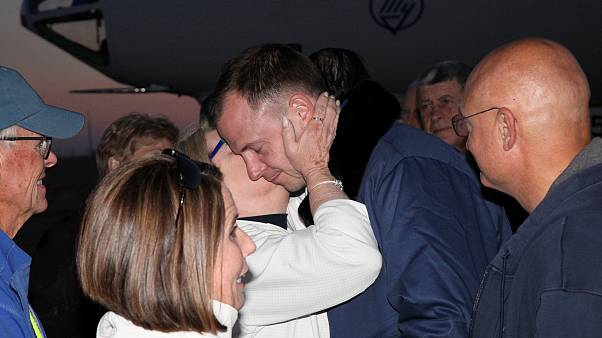 Nick Hague greets family members upon the arrival at Baikonur airport