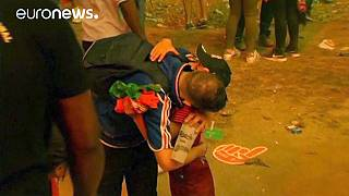 Euro 2016: Distraught French football fan consoled by young Portugal supporter