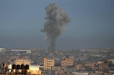 Smoke billows following an Israeli air strike around the southern Gaza Strip city of Rafah on Wednesday.