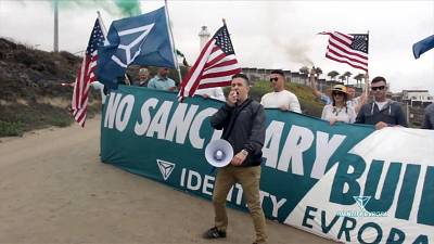Patrick Casey leading a rally at the Mexico border.