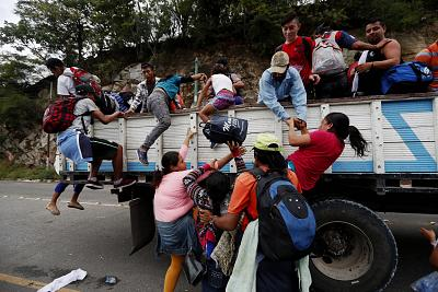 Honduran immigrants get on trucks in Zacapa, Guatemala, on Oct. 17, 2018.