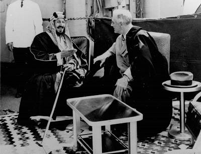 President Franklin D. Roosevelt and King Abdul Aziz discuss Saudi-U.S. relations aboard the USS Quincy north of Suez, Egypt, on Feb. 14, 1945.
