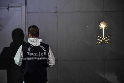 A Turkish forensic police officer carries a box at the Saudi consulate on Wednesday.
