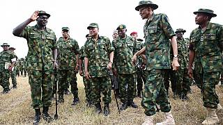 [Photos] Buhari swaps 'Agbada' for full military outfit as he visits troops