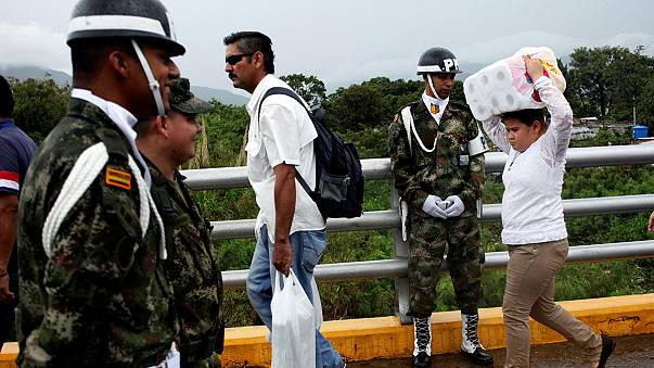 Venezuela reopens Colombian border to allow people to buy basic goods