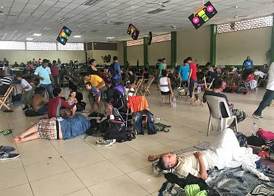 Migrants seek refuge in the Ciudad Hidalgo shelter after crossing the border into Mexico, on Oct. 20, 2018.