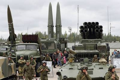 Visitors look at Russian tactical ballistic missiles and multiple rocket launchers during a military exhibition outside St. Petersburg in September 201.