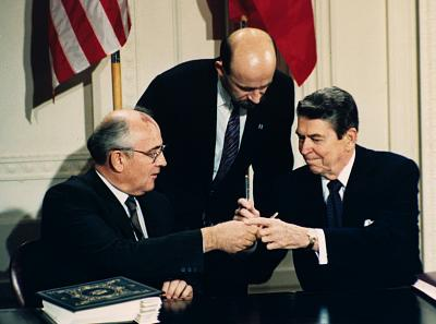 In this Dec. 8, 1987 file photo U.S. President Ronald Reagan, right, and Soviet leader Mikhail Gorbachev exchange pens during the Intermediate Range Nuclear Forces Treaty signing ceremony in the White House East Room in Washington, D.C. Gorbachev\'s translator Pavel Palazhchenko stands in the middle.