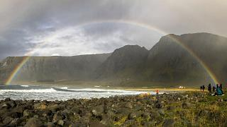 Image: Wintry rain brings a splash of color to the beach in the Lofoten isl