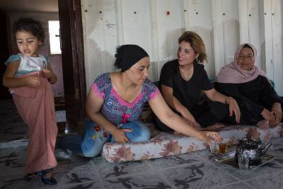 Lawyer and activist Insaf Abu-Shareb, center, enjoys tea with her mother and sister in the house she grew-up in in Esder, an unrecognized Bedouin village in the Negev desert in Israel, on Aug. 9, 2018.