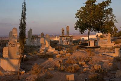 Sunset light hits the cemetery just outside Rahat, the biggest Bedouin city in Israel on July 19, 2018.
