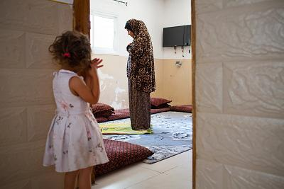 Mona Al-Habnen sets-up for morning prayers in her mother\'s house in the Bedouin city of Rahat in the Negev desert on July 28, 2018.