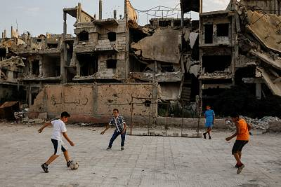 Children play soccer in a government-controlled part of Homs, Syria, on Sept. 18.