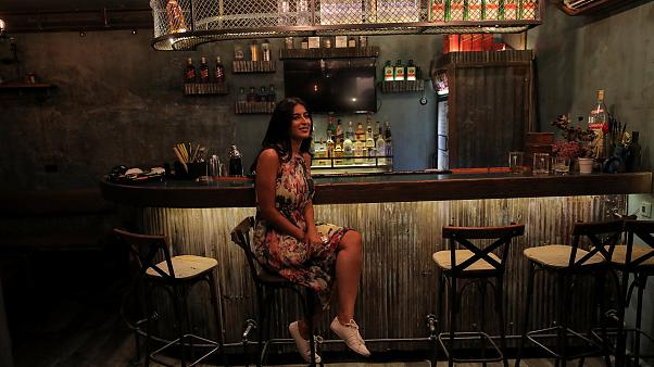 Image: Rasha, 30, the owner of Esco Bar, poses for a photograph in the Old