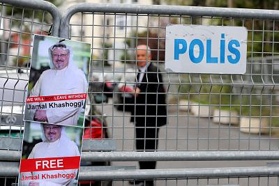 Pictures of Jamal Khashoggi hang on a police barrier during a protest by the Turkish-Arabic Media Association in front of the Saudi consulate in Istanbul on Oct. 8.