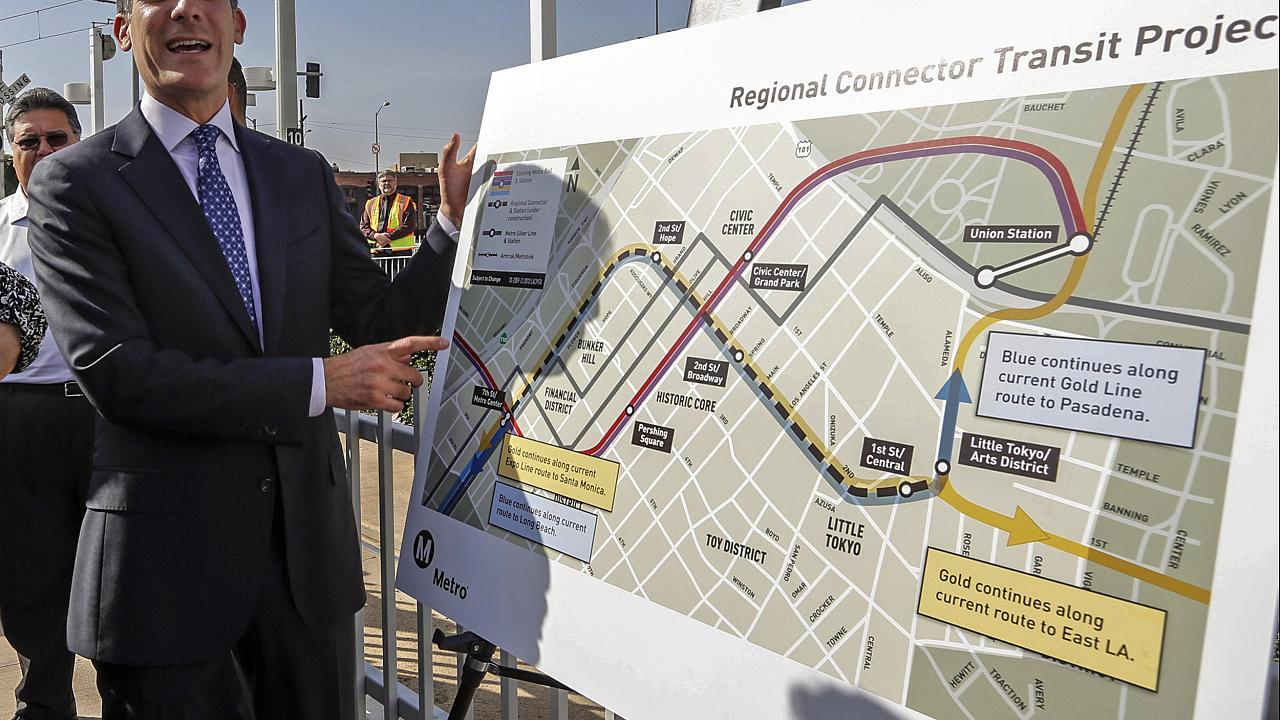 "Image: Mayor Eric Garcetti looks at the proposed ""Regional Connector Transi"